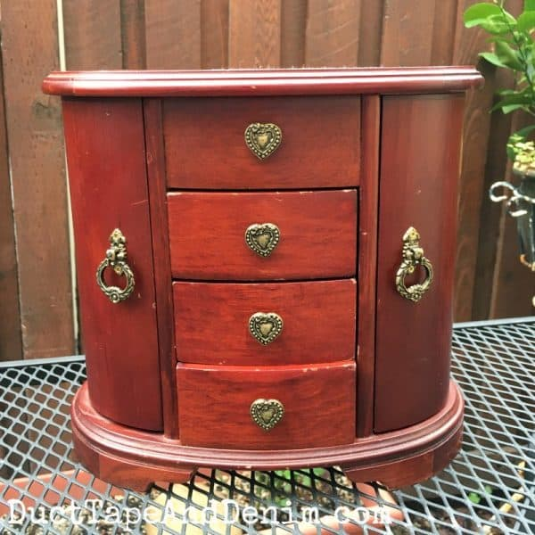 BEFORE painting, thrift store find, jewelry cabinet. See completed makeover on DuctTapeAndDenim.com