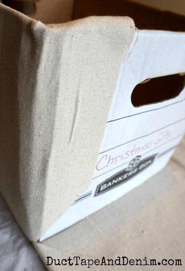 Fold corners, drop cloth covered file boxes | DuctTapeAndDenim.com