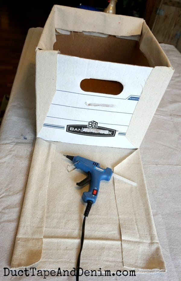 Gluing ends, fabric covered storage box | DuctTapeAndDenim.com