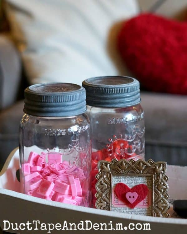 Red and pink Scrabble tiles on coffee table, Valentine's Day decor on DuctTapeAndDenim.com