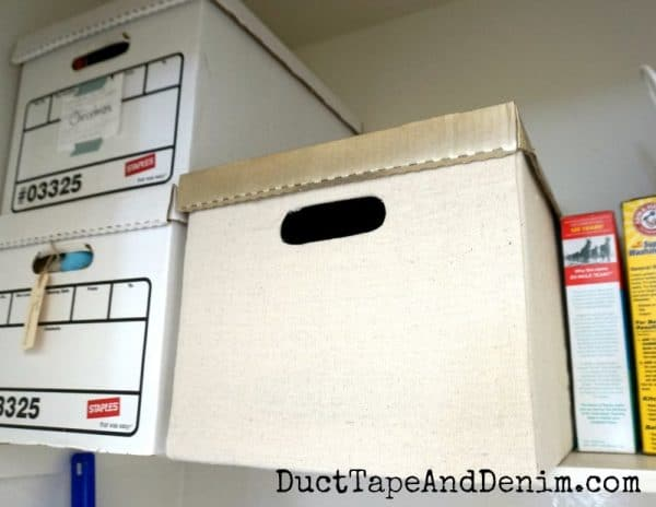 Sneak peek, fabric covered cardboard storage box in laundry room | DuctTapeAndDenim.com