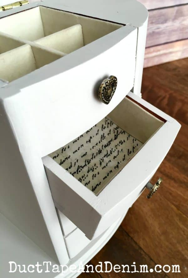 Tissue paper lines drawers of thrift store jewelry cabinet makeover | DuctTapeAndDenim.com