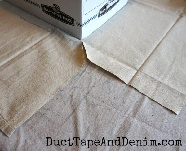 Trim drop cloth corners on file box | DuctTapeAndDenim.com