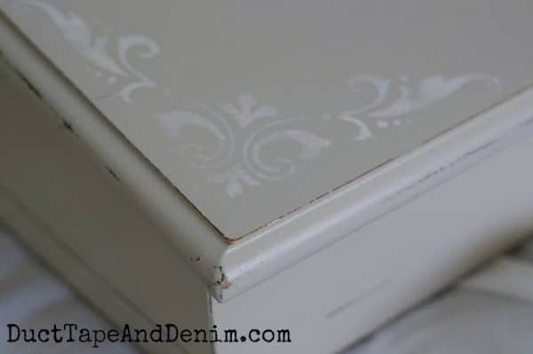 Close up of stencil and distressed details on chalk painted writing desk from thrift store | DuctTapeAndDenim.com