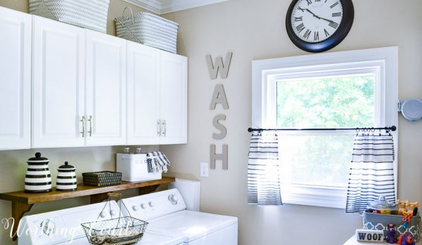 DIY laundry room shelf. See all 5 laundry rooms that will make you want to wash clothes on DuctTapeAndDenim.com