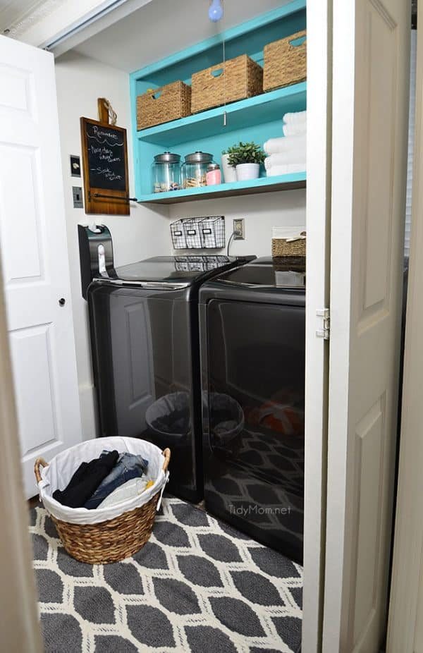 Laundry closet with turquoise shelves.