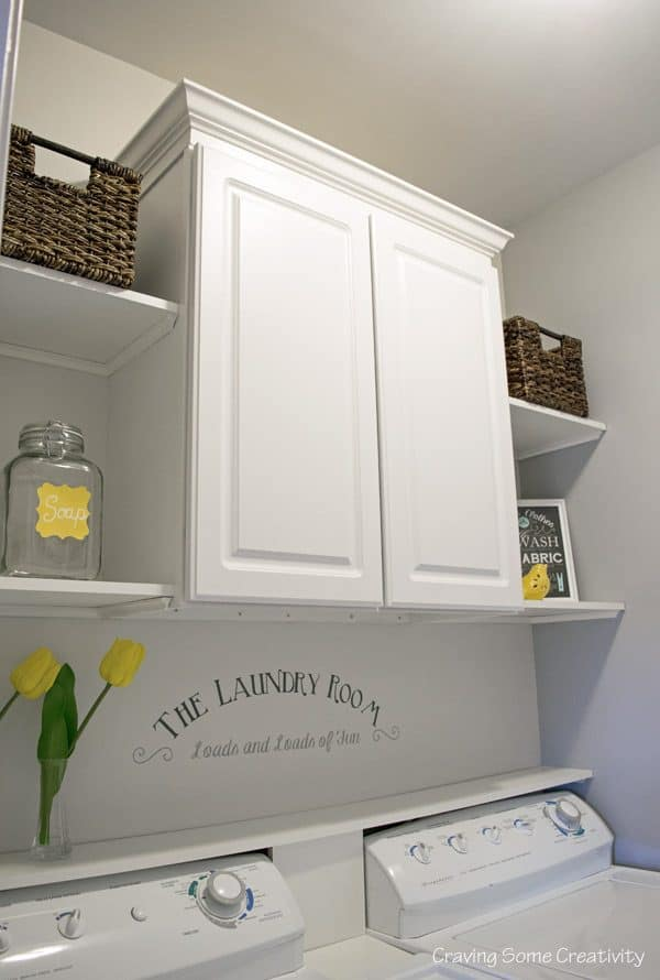 Laundry room cabinet and shelves. See all 5 laundry room makeovers on DuctTapeAndDenim.com
