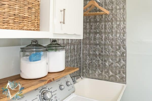 Laundry room utility sink with faux tin backsplash