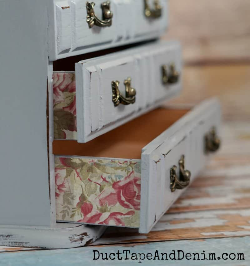 Close up, floral scrapbook paper on sides of drawers