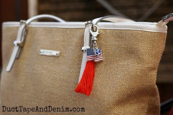 Finished patriotic purse charm with flag, rhinestones, and tassel. Get tutorial on DuctTapeAndDenim.com
