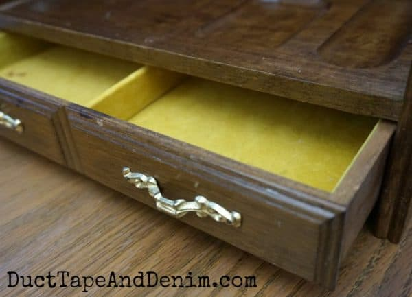 Inside, gold felt, thrift store jewelry box makeover | DuctTapeAndDenim.com