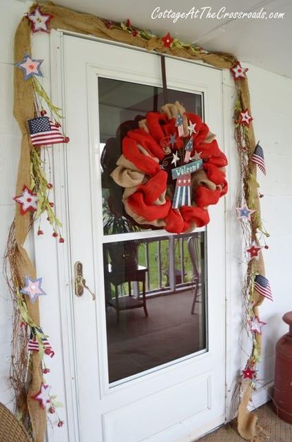 Fourth of July burlap wreath and door decorations. More wreaths on DuctTapeAndDenim.com