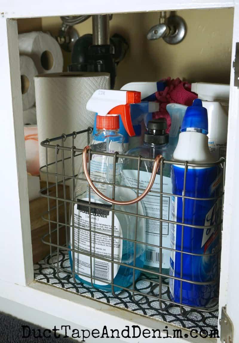 How to organize cleaning supplies under bathroom sink storage | DuctTapeAndDenim.com