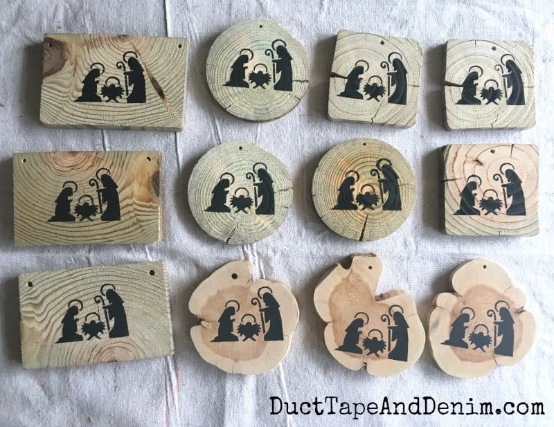 Nativity scenes stenciled on wood scraps