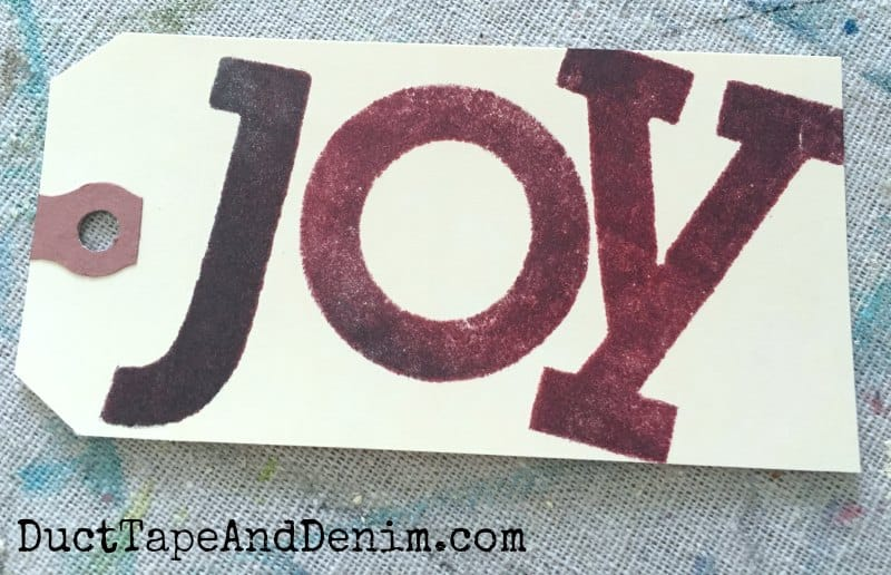 Stamped JOY Christmas gift tag tutorial on DuctTapeAndDenim.com