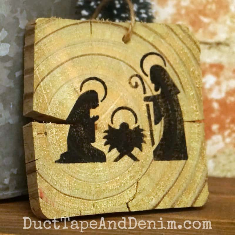 Stenciled nativity Christmas ornament on old wood | DuctTapeAndDenim.com