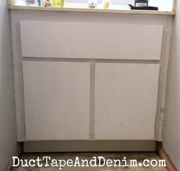 BEFORE painting bathroom cabinet | DuctTapeAndDenim.com