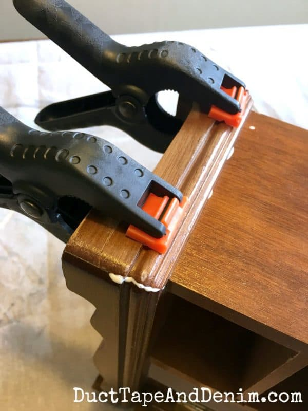 Clamping the broken trim on my jewelry cabinet