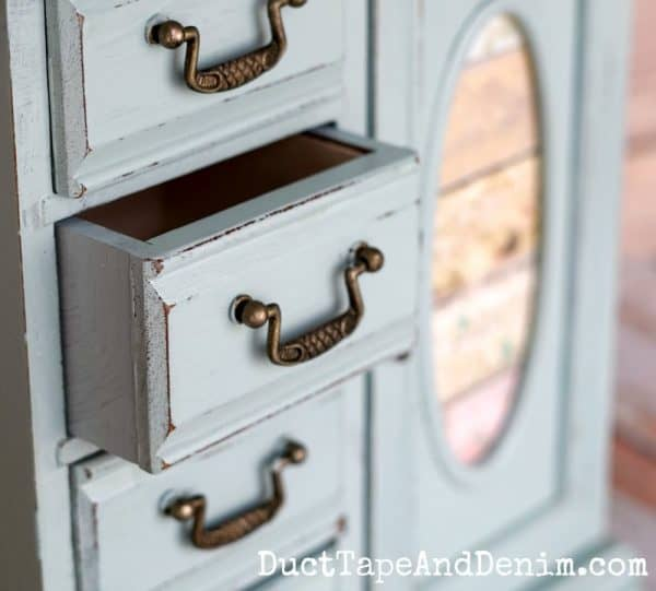 Close up of painted jewelry cabinet drawer