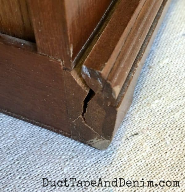 Cracked corner trim on thrift store jewelry cabinet