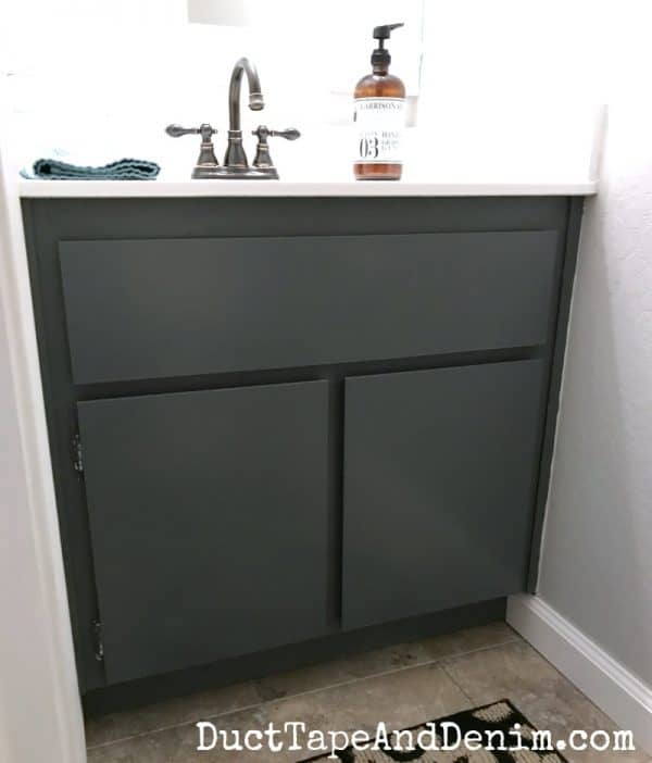 Finished powder room cabinet. How to paint a bathroom cabinet. DuctTapeAndDenim.com