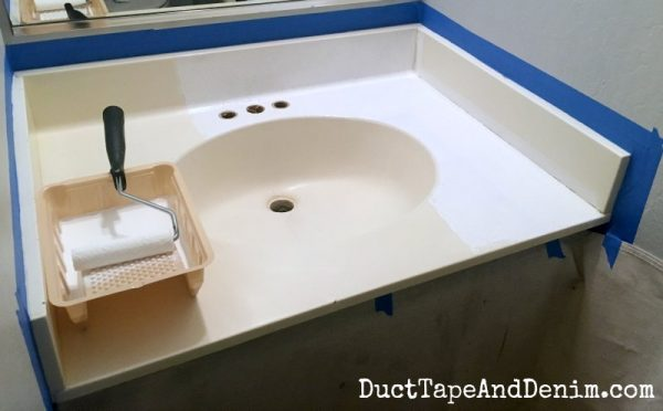 Painting sink in small bathroom