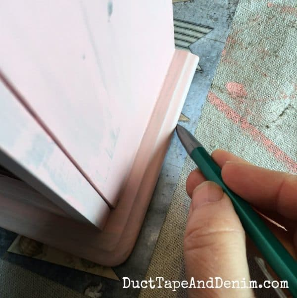 Tracing scrapbook paper for top of pink jewelry cabinet | DuctTapeAndDenim.com