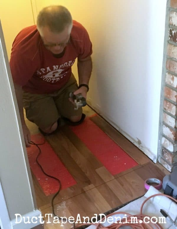 cutting laminate flooring | DuctTapeAndDenim.com