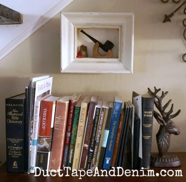 Vintage shadow box frame holds my hubby's old pipe at his desk | Finished chalk painted thrift store find, shadow box frames | DuctTapeAndDenim.com