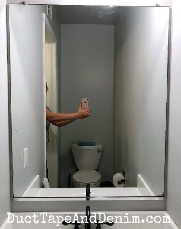BEFORE - Powder room, small bathroom mirror before DIY frame   DuctTapeAndDenim.com