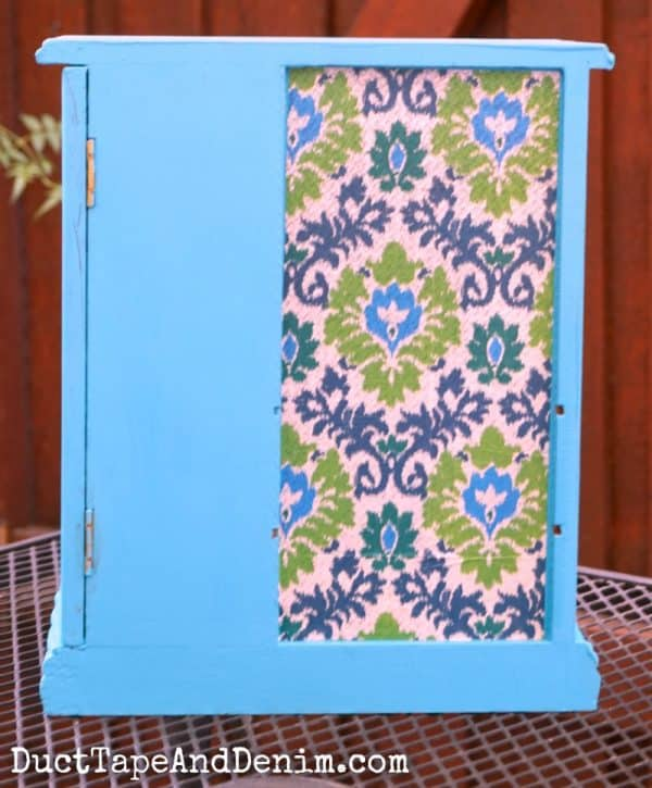 Back of my thrift store makeover, jewelry cabinet with ikat tissue paper | DuctTapeAndDenim.com