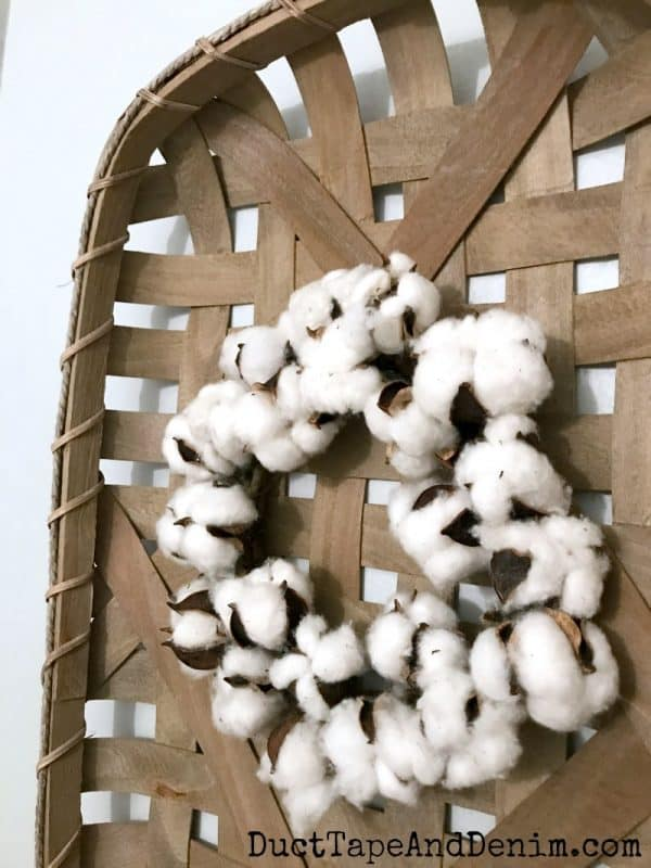Close up of cotton wreath, tobacco basket in my farmhouse powder room makeover
