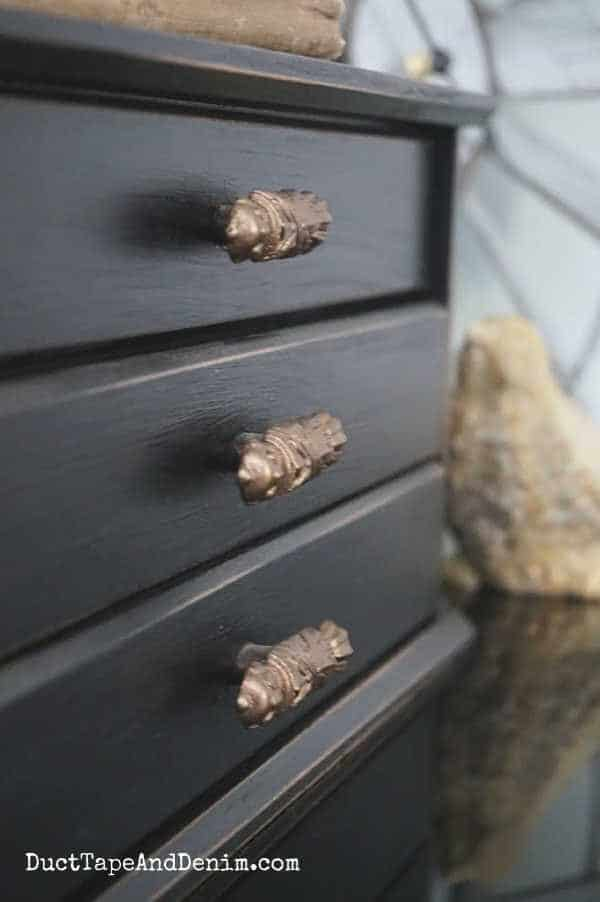 close up of black jewelry box drawers