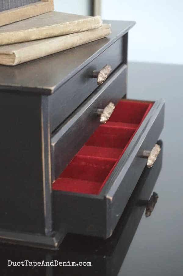 inside of black jewelry box drawers is red
