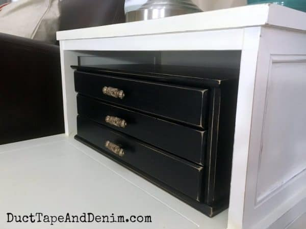 Finished thrift store makeover drawers in black chalk type paint | DuctTapeAndDenim.com