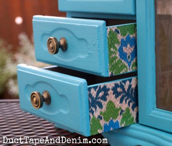 Ikat tissue paper decoupage on sides of my turquoise jewelry cabinet makeover. | DuctTapeAndDenim.com