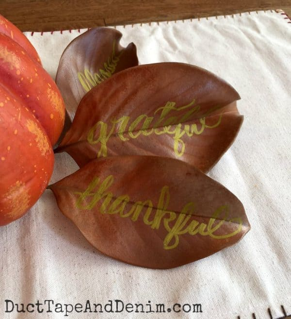 Metallic hand lettering on magnolia leaves for fall home decor | DuctTapeAndDenim.com copy