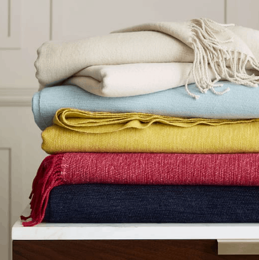 stack of soft throw blankets on sale