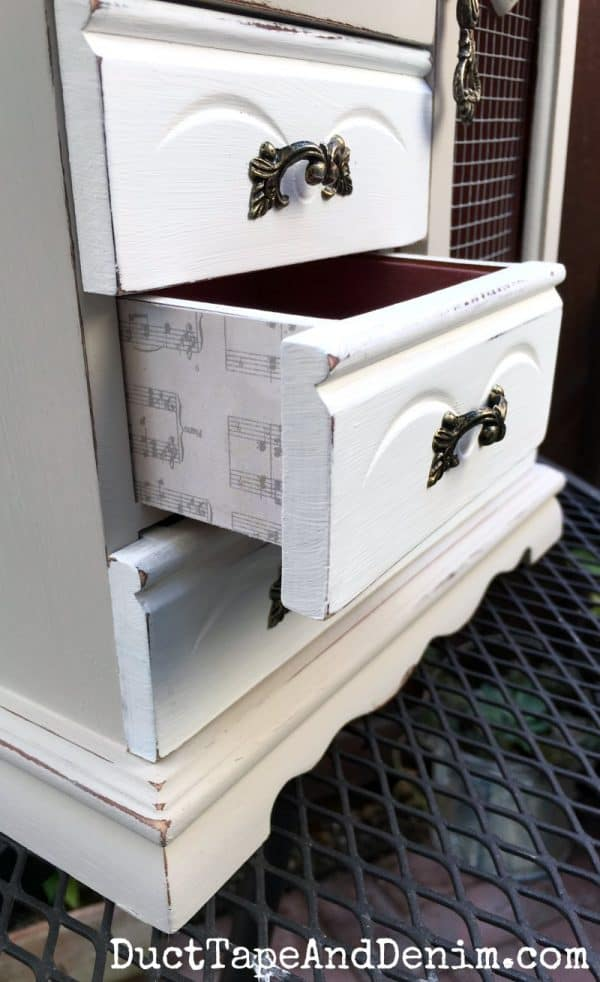 Close up of drawer in jewelry cabinet makeover, how to decoupage on wood jewelry cabinet drawers | DuctTapeAndDenim.com