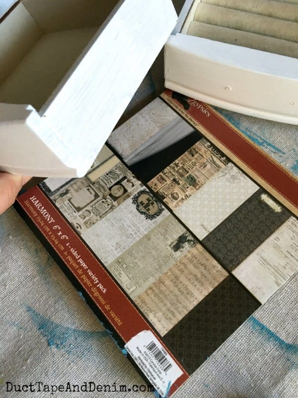 Scrapbook paper for jewelry cabinet makeover
