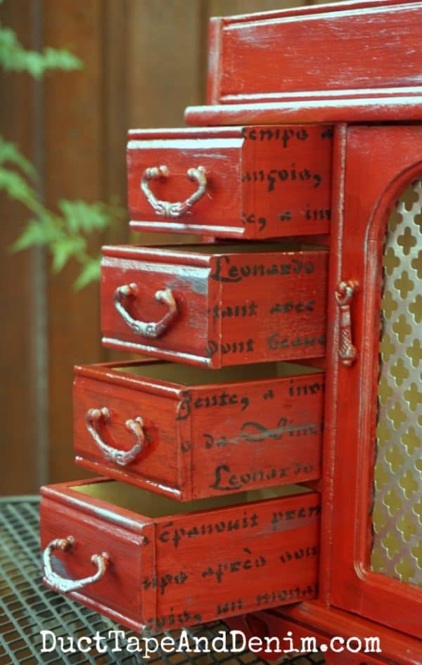 Red jewelry cabinet drawers, stenciled sides