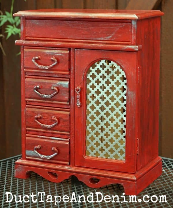 Red jewelry cabinet, thrift store makeover by DuctTapeAndDenim.com