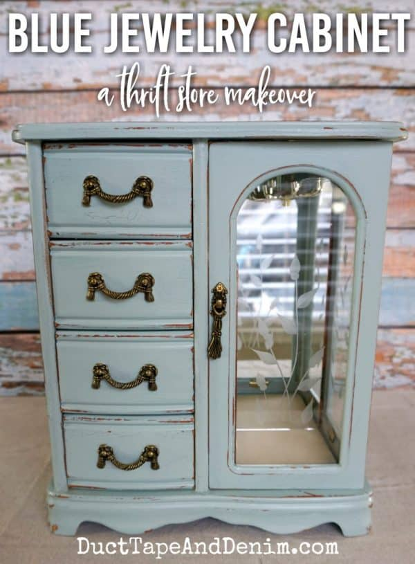 Finished blue jewelry cabinet with mirror makeover, a thrift store makeover on DuctTapeAndDenim.com