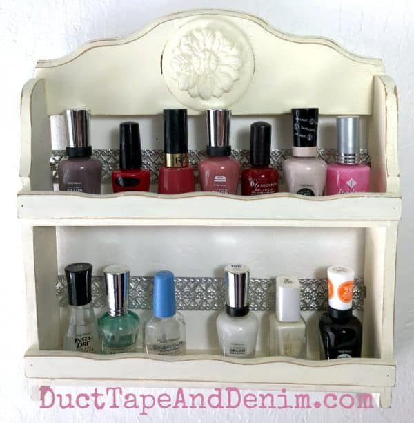 Finished nail polish rack, repurposed spice rack | DuctTapeAndDenim.com #nailpolishrack #woodenspicerack #spicerack #nailpolishholder #nailpolishstorage #nailpolishholder #DIY #thriftstorefind #thriftstoremakeover #chalkpaint #ironorchid #iod #ironorchiddesigns #papercasting #paperclay