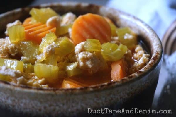 Ground chicken soup, carrots, celery in brown drip bowl | DuctTapeAndDenim.com