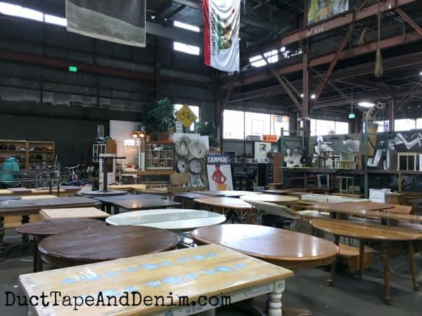 Lots of used tables at Urban Ore in Berkeley | DuctTapeAndDenim.com