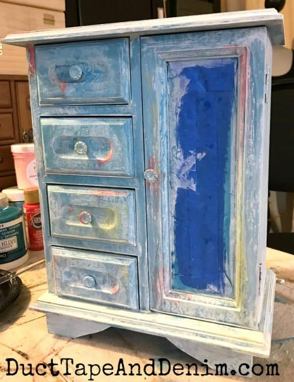 White wash over turquoise paint on thrift store jewelry cabinet makeover | DuctTapeAndDenim.com
