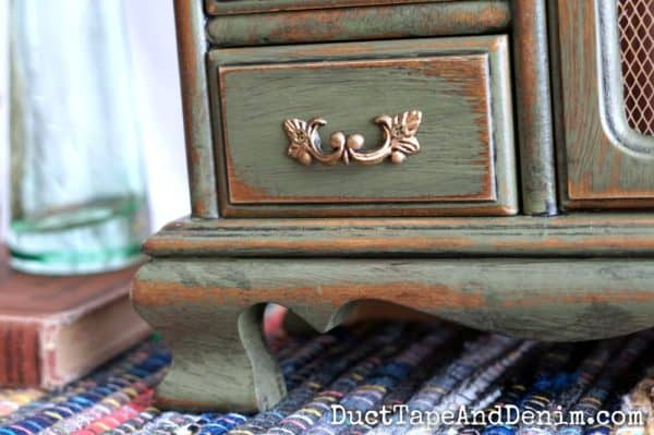 Close up of drawer on green jewelry cabinet makeover