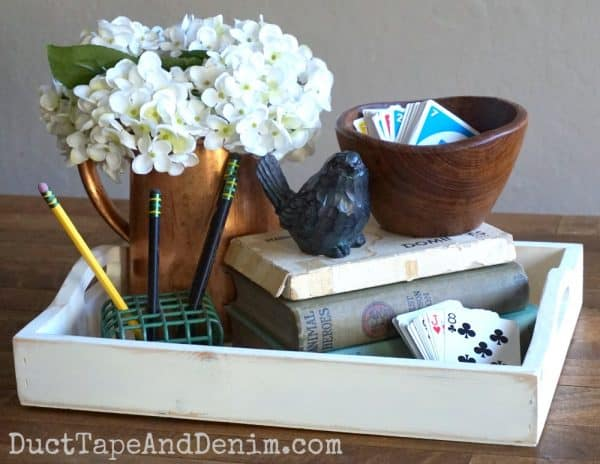 Spring centerpiece for kitchen table with birds and games | DuctTapeAndDenim.com