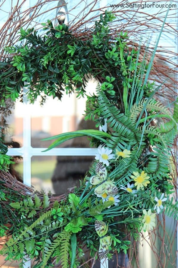 Butterfly and fern wreath